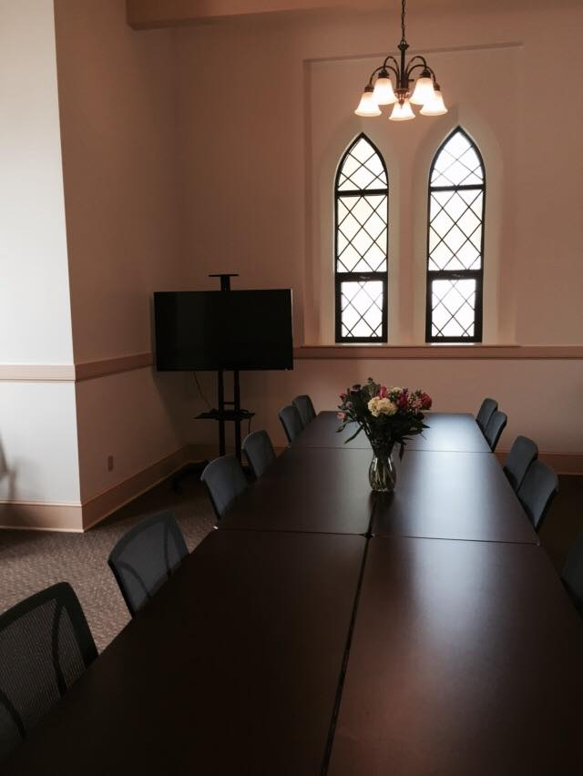 Interior of gate house with tables set up for an event