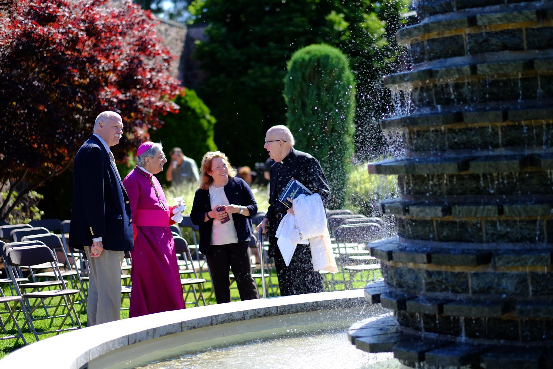 Bishop Matano near a fountain
