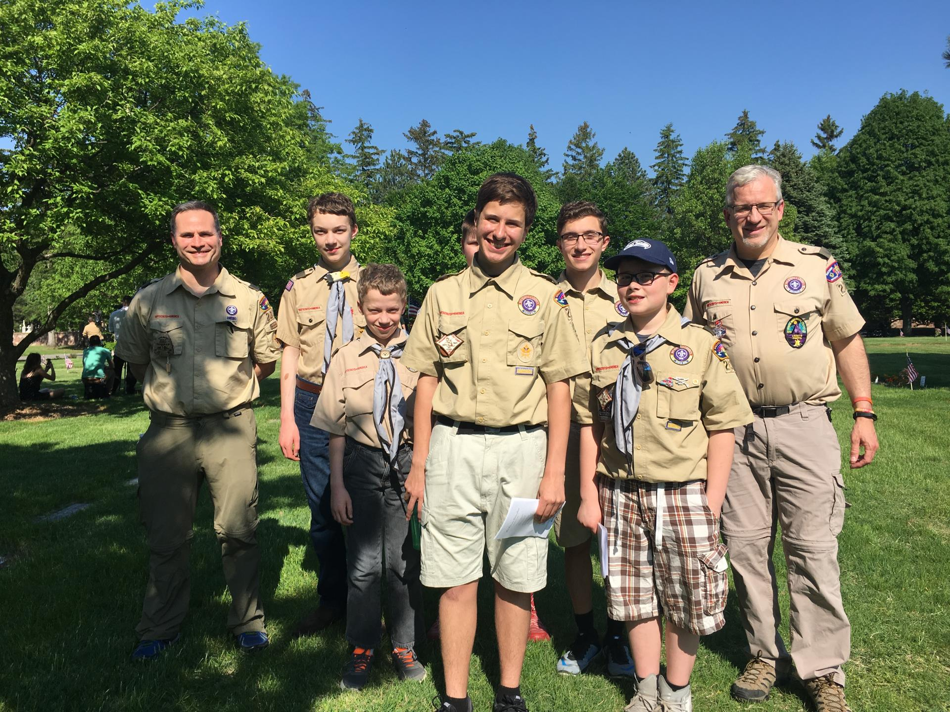 a group of Boy scouts touring the cemetery